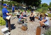 Volunteers gather in the garden before the first outdoor lesson. The course is taught by Lisa Paniaqua, standing on the left, school garden sustainability coordinator for UC CalFresh in San Luis Obispo and Santa Barbara counties.
