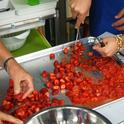 Crushing strawberries for strawberry jam. (Photo: UC Master Food Preserver Program of Orange County)