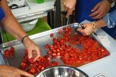 Crushing strawberries for strawberry jam. Photo credit: UC Master Food Preserver Program of Orange County