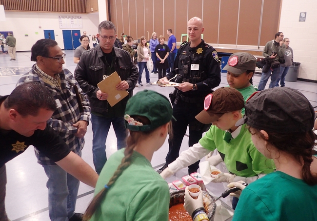 Sherwood Forest 4-H'ers, Vallejo, prepare to serve the judges. From left are Vacaville police officer Jeremy Johnson; John Vasquez Jr., Solano County Board of Supervisors; and Vacaville police officers Shawn Windham and Steve Moore. Windham is also president of the Vacaville Unified School District Board of Trustees. (Photo by Kathy Keatley Garvey)