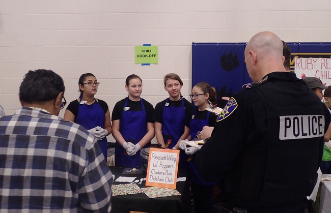 Pleasants Valley 4-H'ers of Vacaville--(from left) Maliyah Desmarais, Maya Farris, Naomi Lipary and Jessie Means-- answer questions from Solano County Board of Supervisor John Vasquez Jr. (front left) and Vacaville police officer Steve Moore. (Photo by Kathy Keatley Garvey)