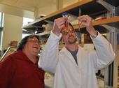 Cynthia Larive and Daniel Orr examine pomegranate juice.