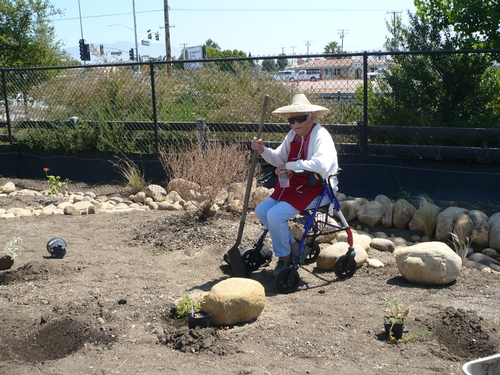 A resident enjoys a 'dry stream bed' in the Veteran's Home Garden.
