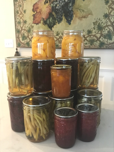 Canned garden produce in jars.