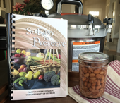 So Easy to Preserve recipe book, pressure canner, and finished jar of canned pinto beans