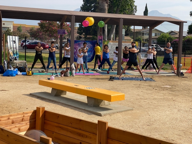 Community members enjoy a yoga and mindfulness class in the Seeds of Joy garden