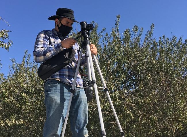 UCCE Community Education Specialist Julio Contreras films cover crop seeding