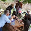 Jeff Mitchell sharing knowledge of soil to farmers in Kenya.