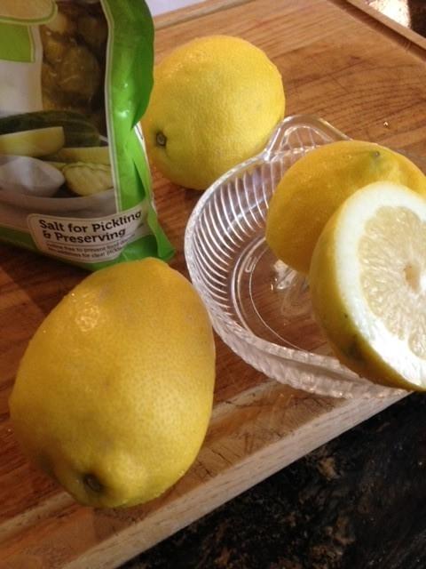 Squeezing lemon halves for juice.