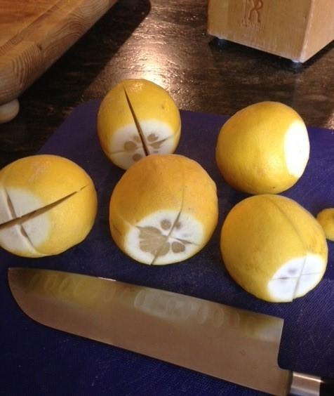 Whole lemons cut into a