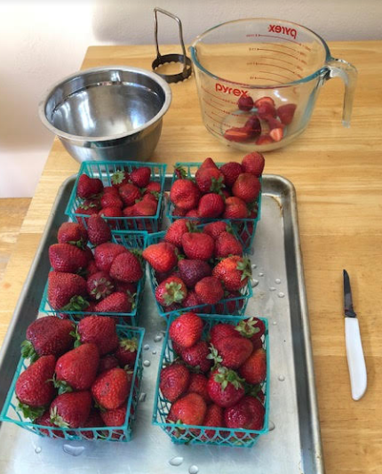 Washed and cut strawberries ready to make jam