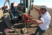 Taking a soil sample at UC Davis' Russell Ranch.