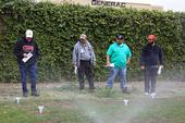 Green Gardener training participants conduct a sprinkler test.