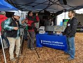 IGIS Drone Pilot and Data Analyst Jacob Flanagan speaks to the local media at the 2019 World Ag Expo