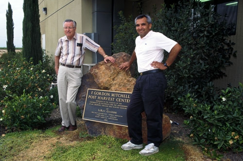 Gordon Mitchell (left) with post harvest scientist Carlos Crisosto in front of the F. Gordon Mitchell Postharvest Center at Kearney.