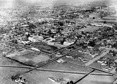 Aerial view of Compton, circa 1936.  Compton Creek is in the foreground.