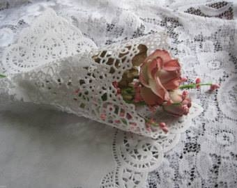 A tiny tussie mussie--looks like the doily is important to being a tussie mussie.