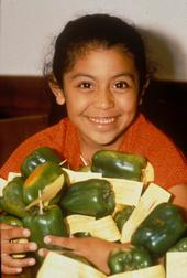 Girl with bell peppers