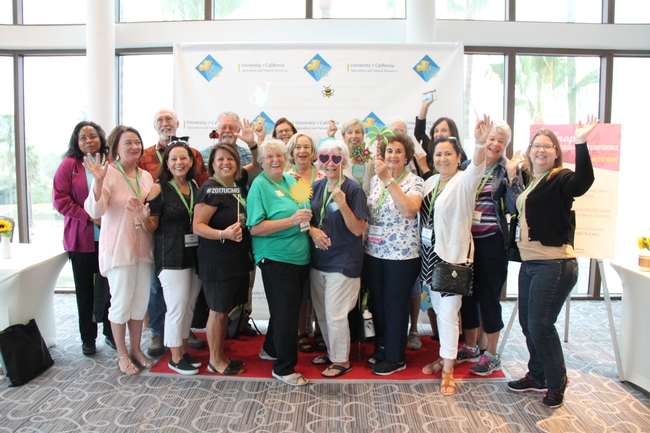 UC Master Gardener volunteers from Riverside County taking a group photo together and having fun in front of the social media photo wall! ©UC Regents / Melissa Womack for UC Master Gardener Program Statewide Blog Blog