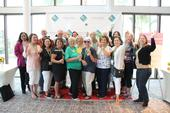 UC Master Gardener volunteers from Riverside County taking a group photo together and having fun in front of the social media photo wall! ©UC Regents / Melissa Womack