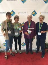 UC Master Gardeners taking photos with friends and fellow volunteers at the social media wall at the conference. Photo credit: Sheila Clyatt