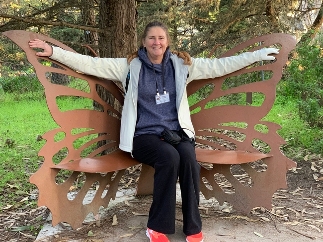 Hafner sitting on a monarch butterfly bench