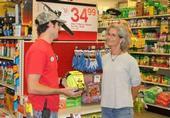 Retailer speaking with customer