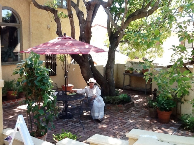 View of the lower patio and Trisha, Master Gardener.