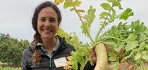 Alli holding a daikon radish. for UC Cooperative Extension, Ventura County Blog