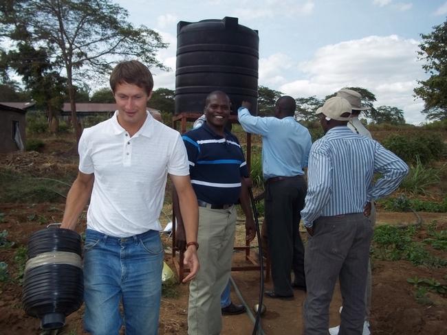 Oleg Daugovish demonstrating gravity-flow drip line irrigation system in Kenya.