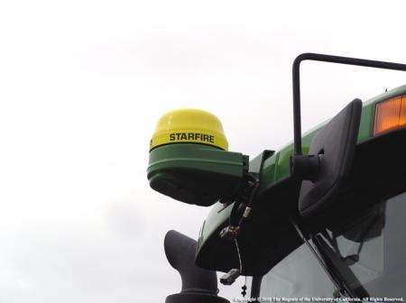 GPS receiver mounted on a tractor cab. GPS systems are increasingly used in agriculture. Photo J. Williams.