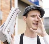 Image: newspaper man selling papers yelling.