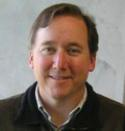 Photo of Dr David A. Mills