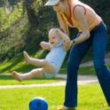 Toddler and Adult at Play with Soccer Ball