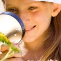 Girl Discovering Nature with Magnifying Glass