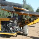 Experimental Olive Harvest: An Orchard Machine Company harvester, provided by Don Mayo of OMC