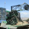 Experimental olive harvest: harvester turning at the end of the row