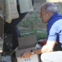 Experimental olive harvest: Jose catching a sample from the transport belt