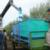 Experimental olive harvest: The chute directs olives into a bin