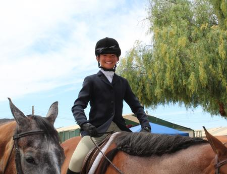Youth in English riding gear on brown horse, Horse Classic 2019