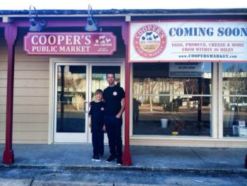 Dennis Cooper and son in front of Cooper's Public Market
