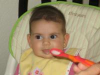 Infant girl eating