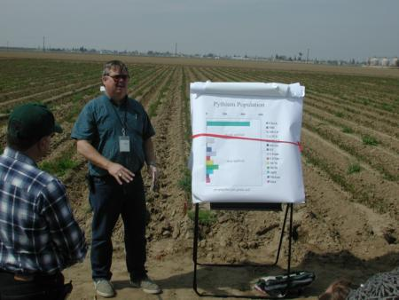 2002 field day discussion of shank- and drip-applied methyl bromide alternatives in a garden rose nursery trial.  Photo by S. Schneider.