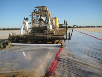 Commercial fumigation rigs shank-injecting a fumigant and installing plastic film. Photo by Brad Hanson