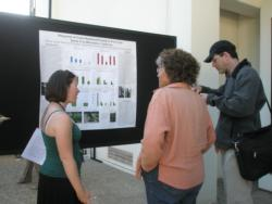 Jodi Frediani, Forestry Consultant with the Sierra Club (center) listens to a poster explanation.