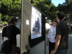 Poster presenter discussing her research.