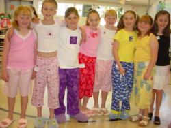4-H members showing off the pajamas they sewed.