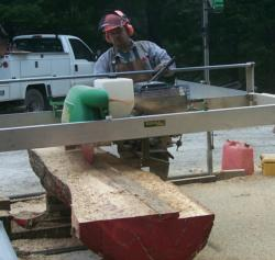 Sawing of logs using Lucas mobile sawmill