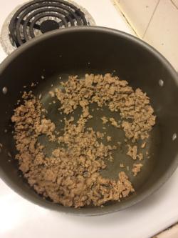 Over medium heat, brown 1/2 pound (8 oz) ground turkey.