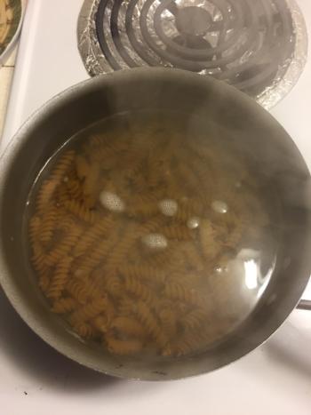 Boil 1/2 a box of pasta.